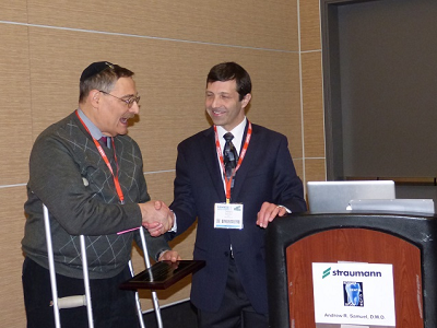 Dr. Matthew Zizmor - founder of the Kosher Dental Study Club - presenting Dr. Andrew Samuel with a plaque at the 1st Annual Lunch and Lecture at the Yankee Dental Congress 2014