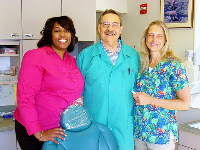 Dr. Matthew Zizmor with office manager Nakeeia and dental hygienist Liz